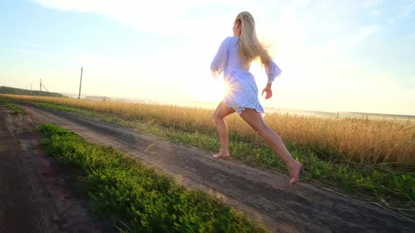 Thumbnail for Beauty Girl Running on Yellow Wheat Field. Freedom Concept, Happy Woman Outdoors, Harvest
