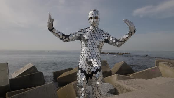 Sparkling Discosuit Man Dancing Next to the Sea