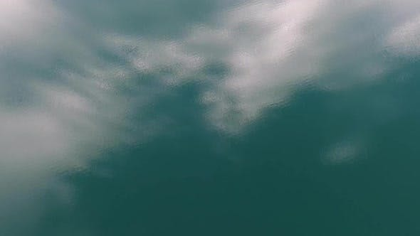 Thumbnail for Flying Over Water Surface with Clouds Reflection