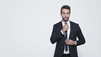 Businessman Adjusting Suit