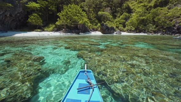 Island Hopping Tour Boat Approaching Exotic Remote Beach on Travel Trip Exploring Bacuit Archipelago