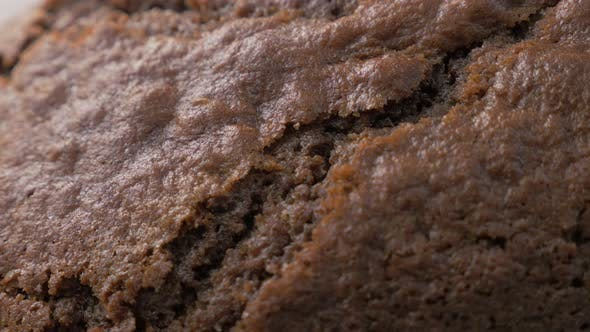 Thumbnail for Chocolate cake glazed  and cracked surface close-up 4K 2160p 30fps UltraHD footage - Tasty looking