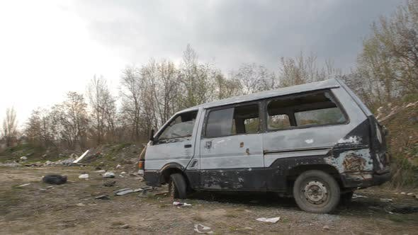 Cover Image for Illegal Garbage Dump with Abandoned Cars in City