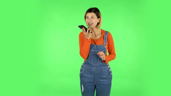 Thumbnail for Girl Asks for Information on the Network Via Phone on Green Screen