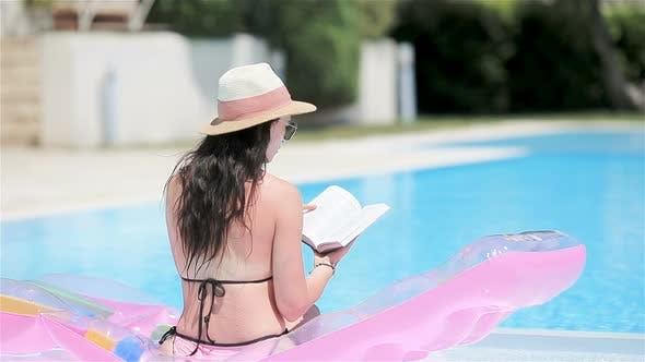 Thumbnail for Young Woman in Bikini Air Mattress in the Big Swimming Pool