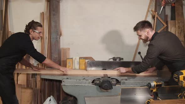 Two Carpenters are Working in a Wood Factory