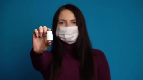 Woman Presenting a Hand Pills.