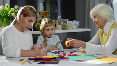 Women Doing Crafts with Little Girl