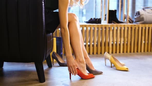 Thumbnail for Young Woman Trying Heeled Shoes at Store 11