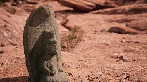 Ancient Statue on the Rocks Desert