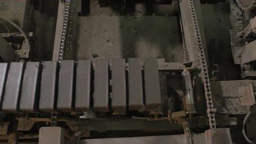 Machinery with bricks