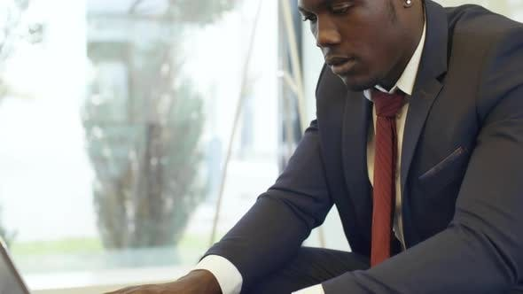Thumbnail for Black Entrepreneur Working with Laptop in Office