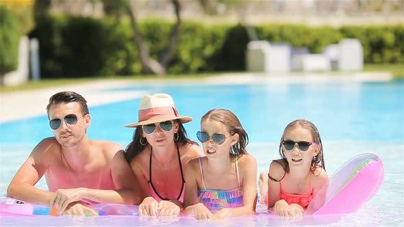 Thumbnail for Happy family in swimming pool