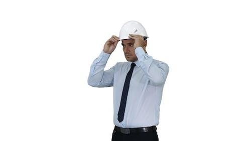 Businessman Putting Hardhat Helmet on Safety on White Background
