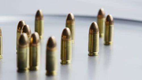 Cinematic rotating shot of bullets on a metallic surface - BULLETS 055