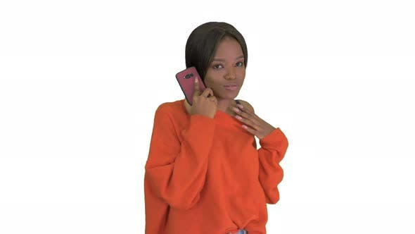 Pretty African American Woman in Bright Jumper Talking on the Phone and Gesturing Emotionally