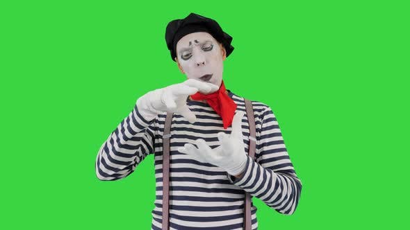 Thumbnail for Mime Artist Holding Imaginary Ball on a Green Screen Chroma Key