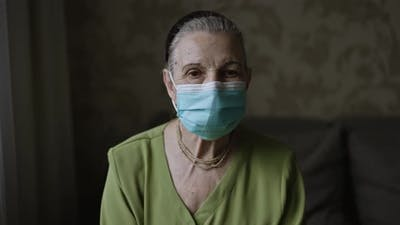 Grandmother in Face Mask Lat Home