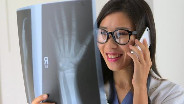 Thumbnail for Chinese doctor talking to patient on iphone
