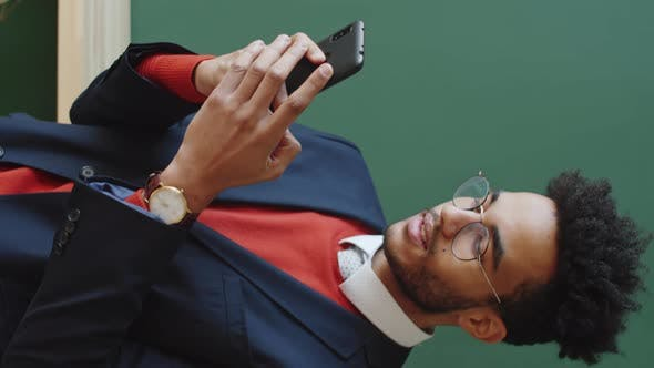 Thumbnail for Young Businessman Texting on Smartphone