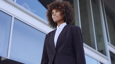 Businesswoman Walking Outside Office Building