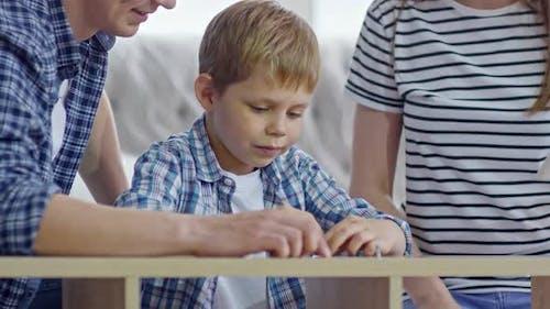 Boy Assembling Furniture