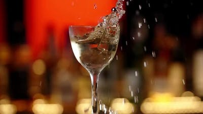 Olive on a Skewer is Falling to the Cocktail with Splash in 240Fps Slow Motion Making the Cocktail