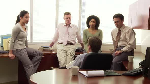 Thumbnail for Young business collegues discussing work in office