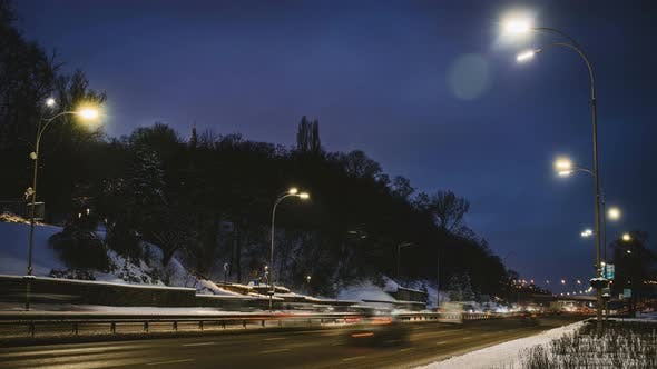 Thumbnail for City Traffic in Winter Near the Bridge