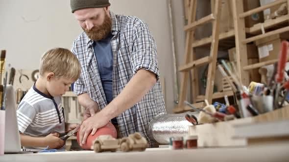 Thumbnail for Boy Cutting Cardboard Cone