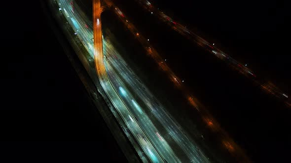 Thumbnail for Night Timelapse Aerial View of Busy Traffic Road with City Skyline