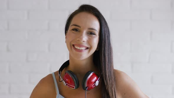 Thumbnail for Cheerful Brunette with Headphones