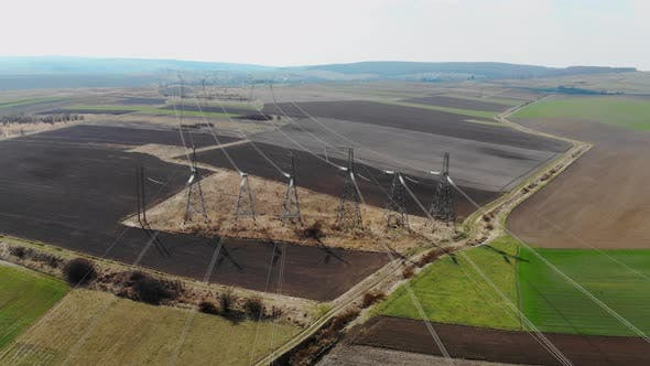 Aerial View Long Distance Transmission Lines, High-voltage Pillars That Energy Efficiently Deliver