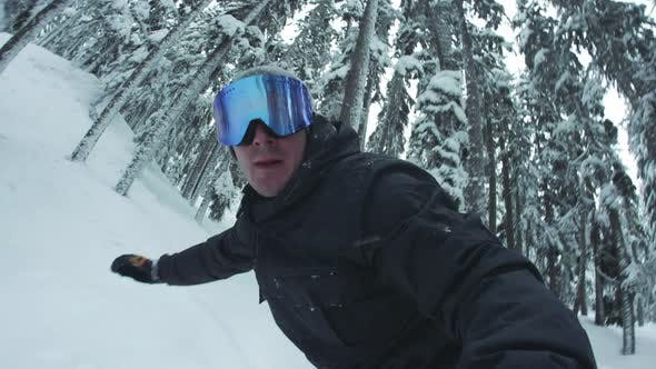 Thumbnail for Man Snowboarding Hand Holding Dslr Camera In Trees