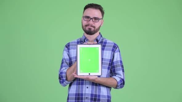 Thumbnail for Stressed Young Bearded Hipster Man Showing Digital Tablet