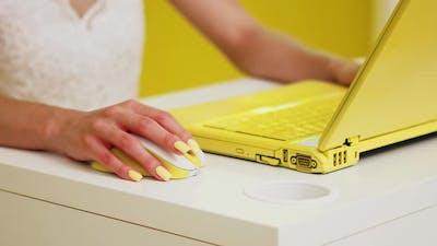 Woman Uses Yellow Laptop Indoor