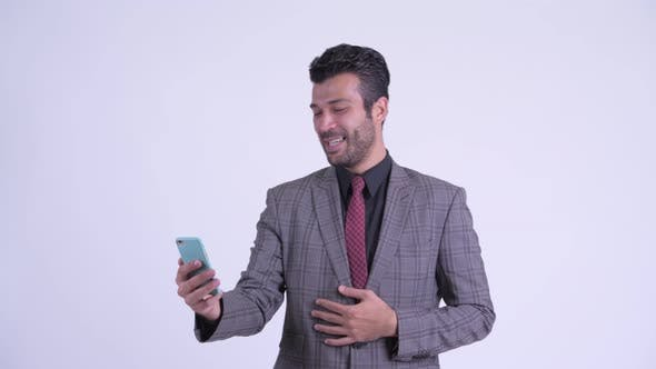 Thumbnail for Happy Bearded Persian Businessman Video Calling and Showing Phone
