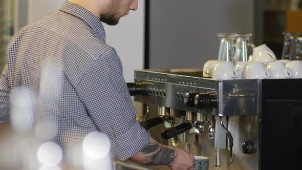 Thumbnail for Tattooed Male Barista Making Double Americano