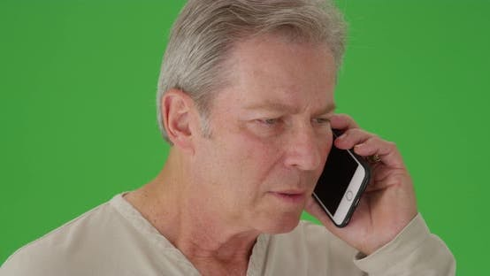 Thumbnail for Mid aged caucasian man on a cellphone