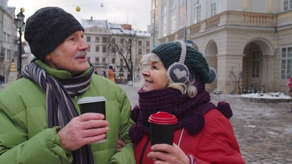 Thumbnail for Senior Wife Husband Tourists Drinking From Cups Enjoying Hot Drink Tea on City Central Street