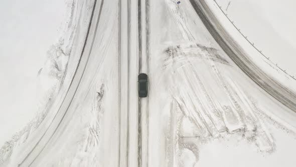 Car Rides a Bridge. Car Driving on Winter Country Road, Aerial View From Drone in . Top View