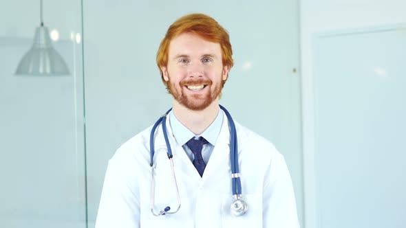 Thumbnail for Portrait of Smiling Positive Doctor in Clinic