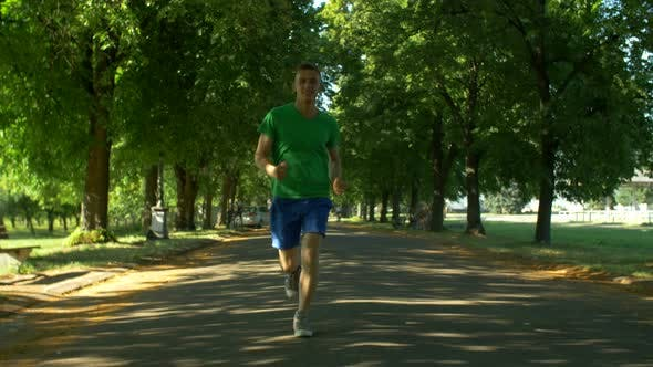 Thumbnail for Athletic Young Man Running in Public Park