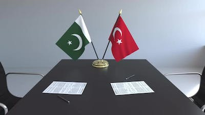 Flags of Pakistan and Turkey and Papers on the Table