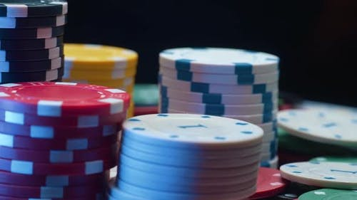 Casino Chips and Playing Cards in Motion
