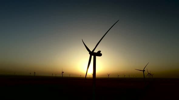 Thumbnail for Work of Wind Turbines in Wheat Fields During the Colored Summer Sunset, Silhouette, Aerial Survey