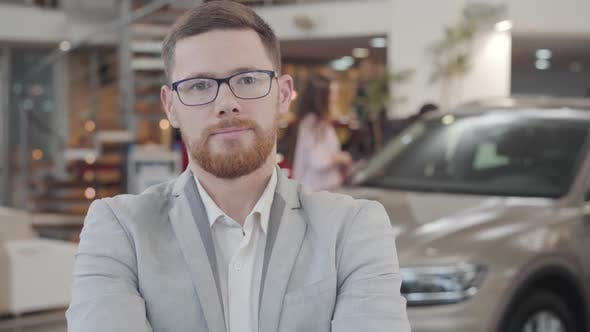 Thumbnail for Close-up Face of Young Caucasian Car Dealer Gesturing Yes By Shaking Head and Smiling