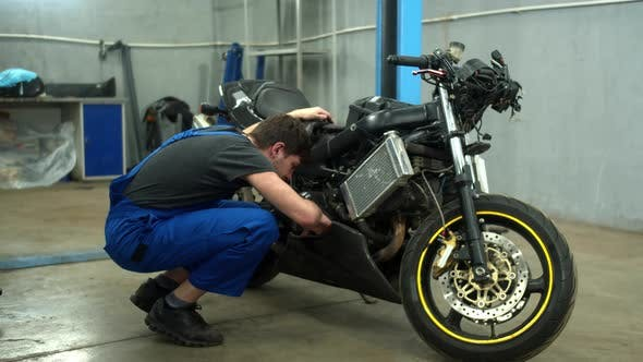 Thumbnail for Mechanic Examines a Motorcycle in Auto Repair Shop