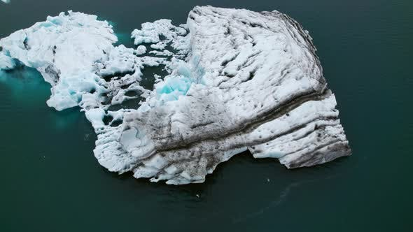 Top Down Aerial Shot of the Beautiful Ocean Scenery With Iceberg Scattered