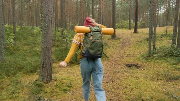 Thumbnail for Tourist in Sweater with Backpack Runs and Spins in Forest